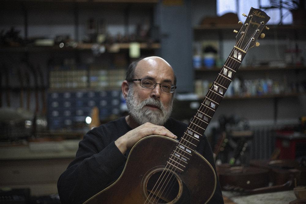 John Thomas at Retrofret Guitars in Brooklyn. [Emon Hassan/Guitarkadia]