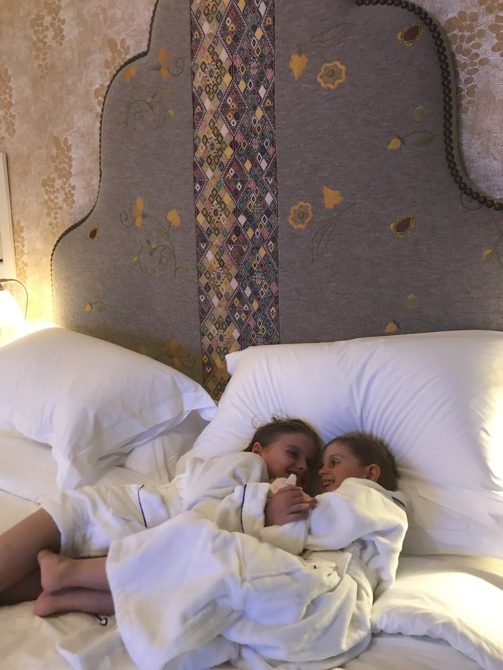 Amenities for the littles at Firmdale's new  Whitby Hotel  in New York: Robes, slippers, fresh popcorn, and movies.
