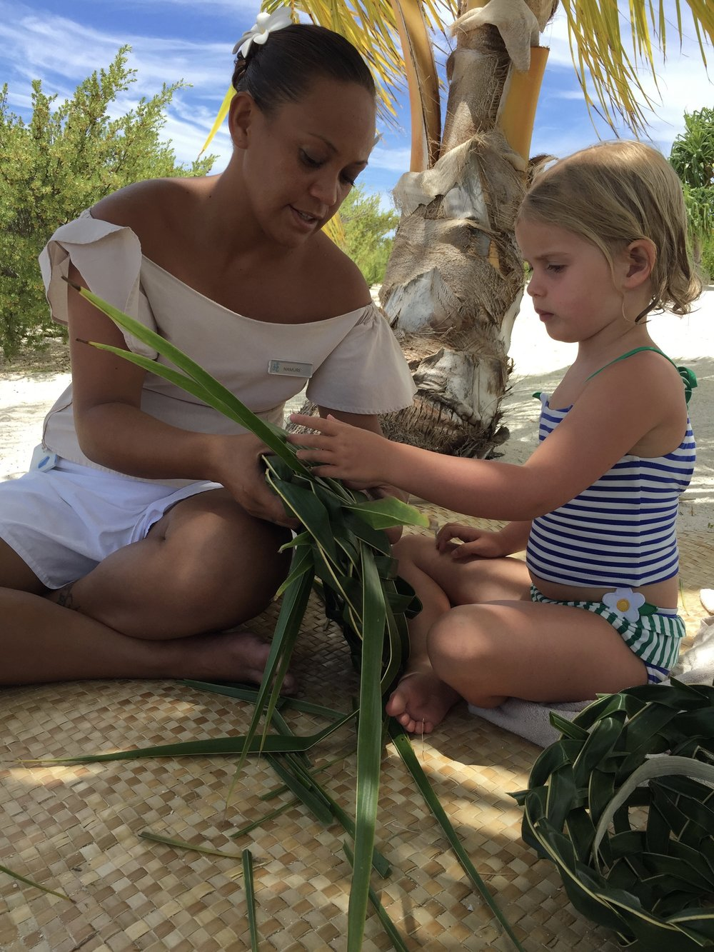 Making palm frond baskets at the  Brando  in French Polynesia.