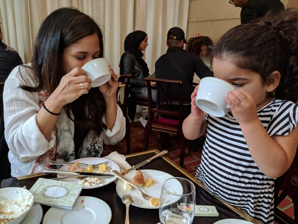 Sipping tea at  Ladurée Paris Champs Elysees  on Mother's Day. While this upscale spot might seem an intimidating choice with children, they are well prepared with crayons and coloring books.