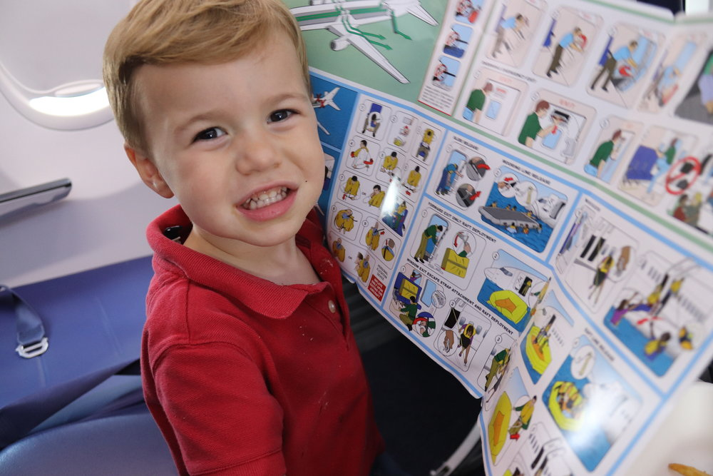 One happy jetsetter:  Kids can be unpredictable, but they sure do love to fly.