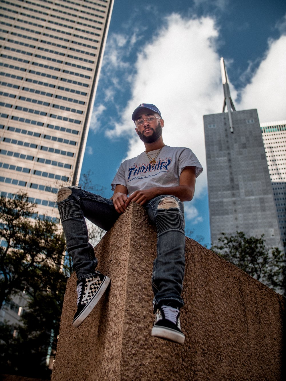 Young man sitting in city.jpg