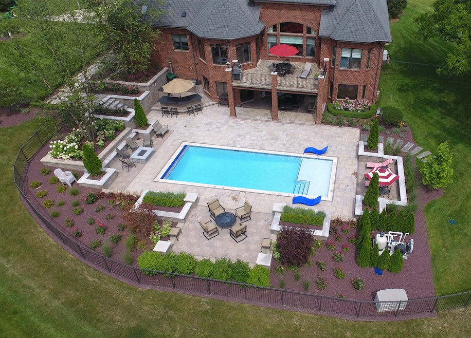 Landscape design with concrete pavers and bluestone in Macomb MI