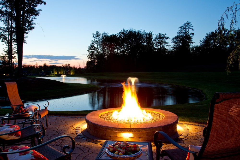Landscape design with outdoor fireplace in West Bloomfield Township MI