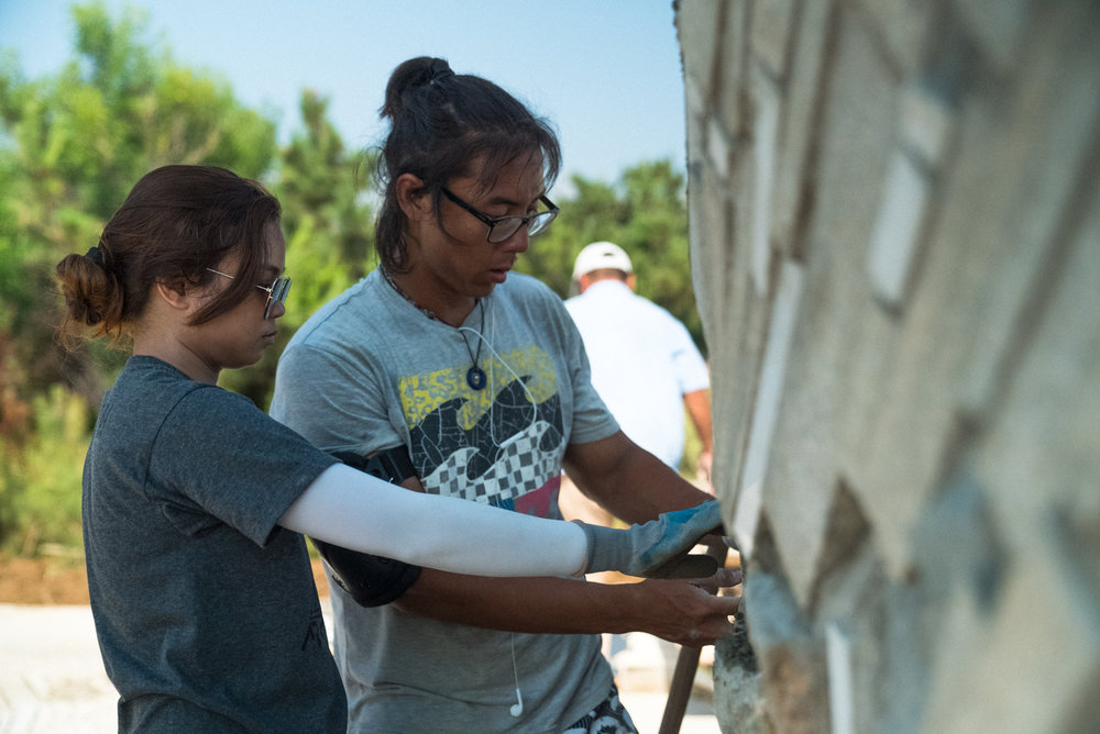 Pablo and Krista Finishing A Spectacular Wall