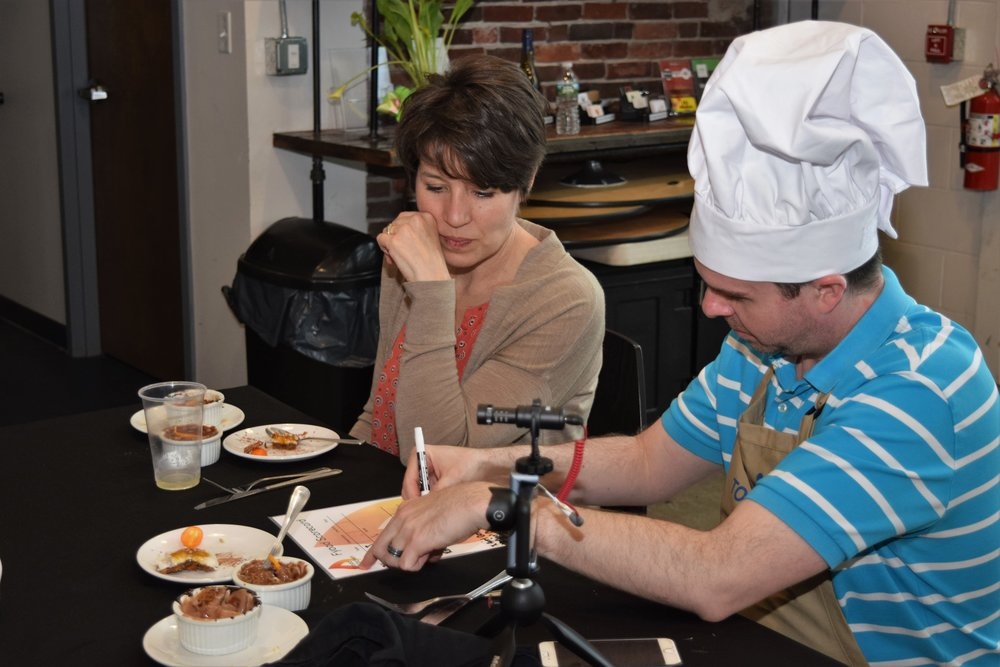 Team judges collaboratively at office cooking competition