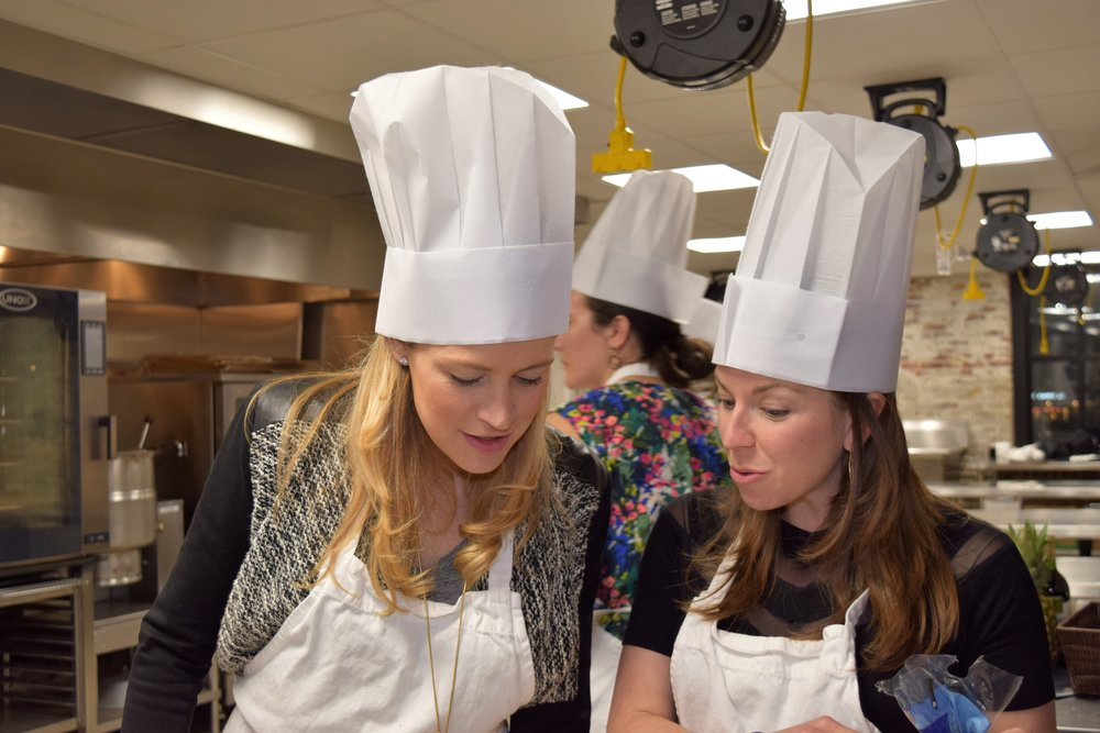 Women in chef hats brainstorming