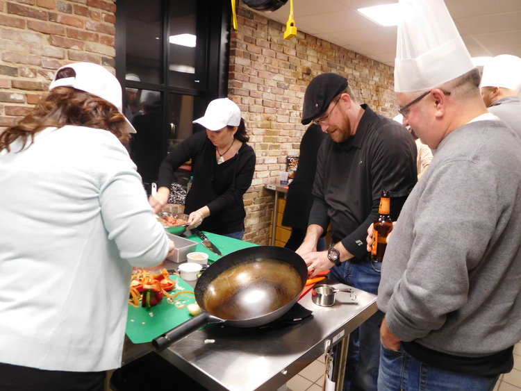 Birthday Party Chef Hats And Balloon Decorations Team Of Amateur Cooks Competing With Wok