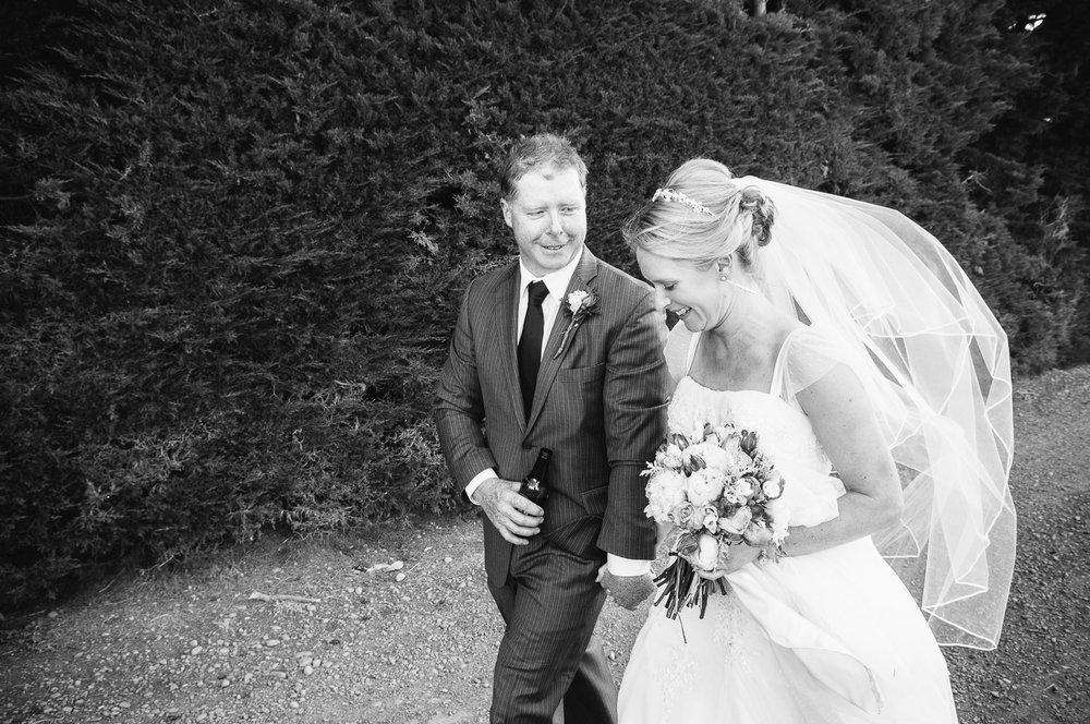 Farm wedding, St Mary's Leeston, Nicola & Nathan walk hand-in-hand.
