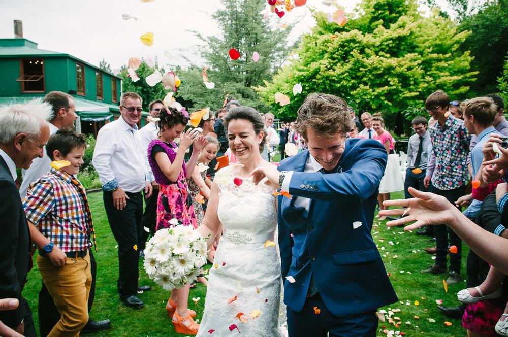 Langdale Vineyard Wedding, Jodie & Jacob showered in flower petals
