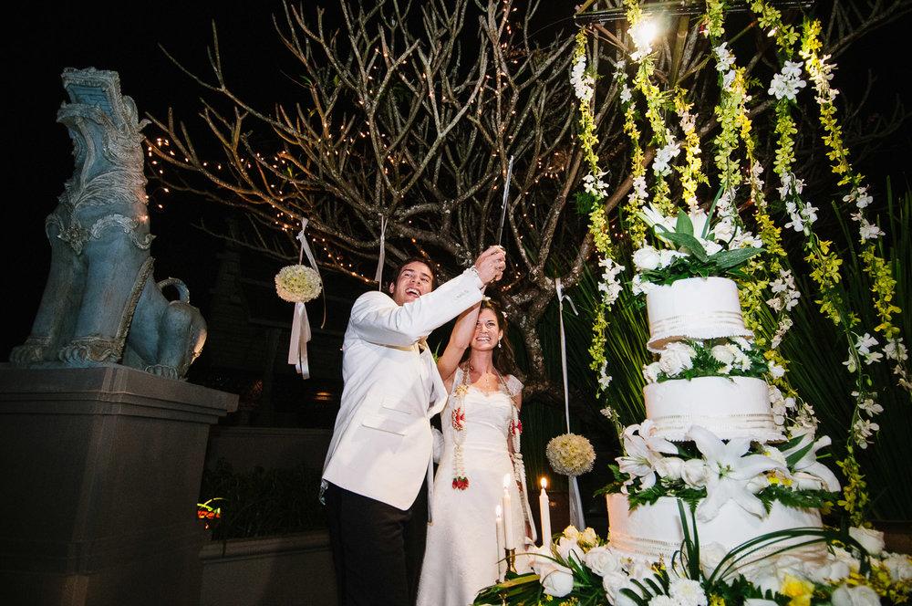 Four Seasons Resort Chiang Mai Wedding, Katie & Tim cutting the cake.