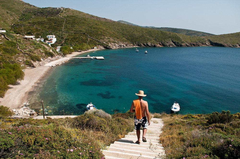 Man walking down to a beach, Fourni Islands, Greece.