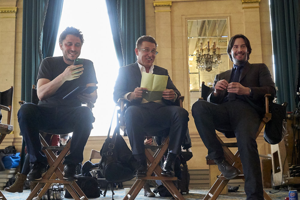 Director Matthew Ross and stars Pasha Lychnikov and Keanu Reeves on the SIBERIA set