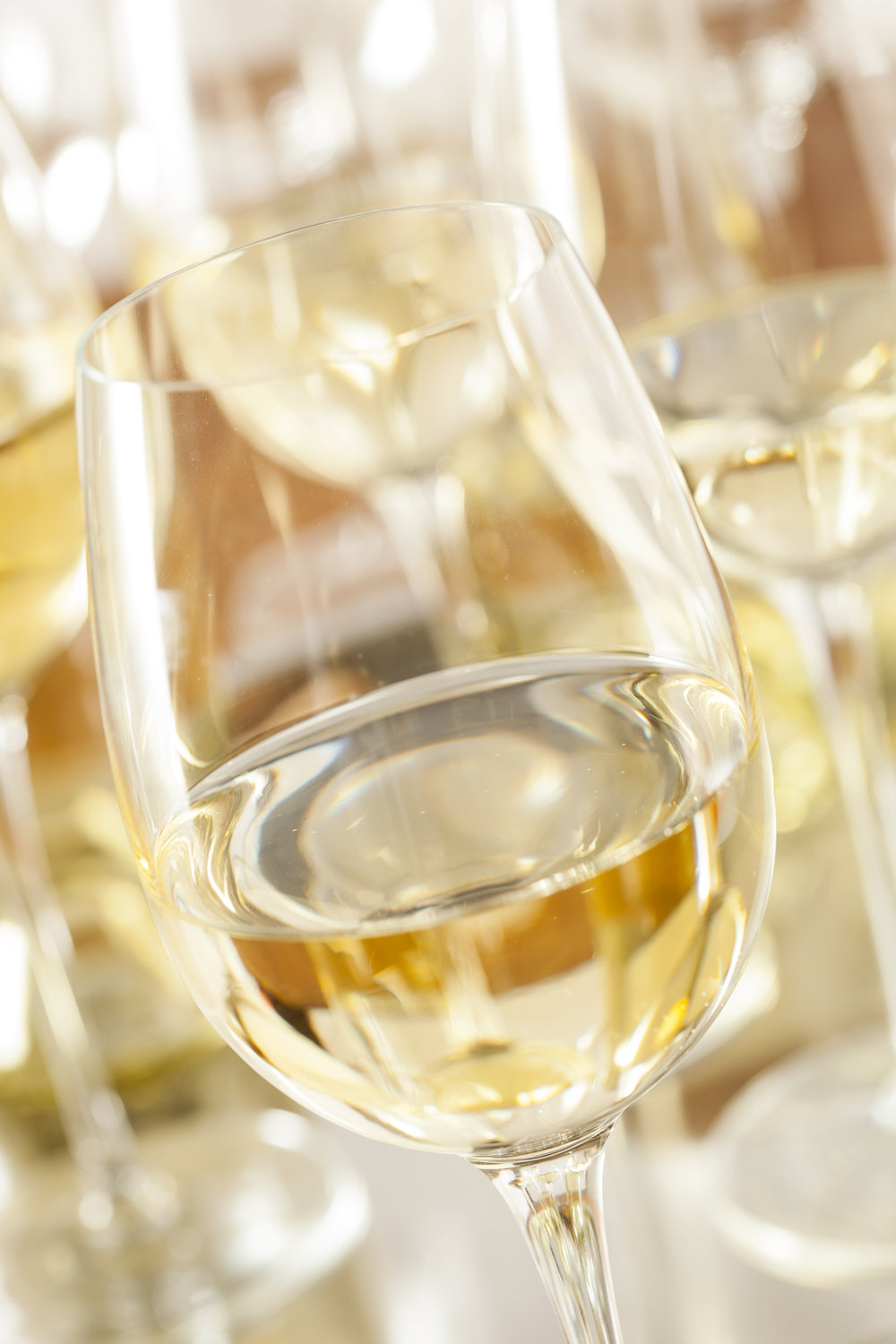 Refreshing White Wine in a Glass on a Background.jpg