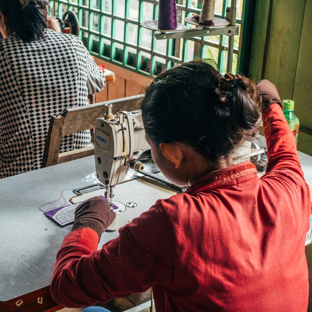 Chaya | Pattern Maker | Rajana Association - My name is Chaya. Since my husband passed away in a traffic accident 16 years ago, I have been raising my son as a widow. For the last 8 years, I have been working with Rajana Association as a sewer and pattern maker. I love this work very much because it helps me to learn a specific skill and build a long-term career while supporting myself and my son and his future. I want to have my own business in the future. Although I have many years of experience, I still face a lot of problems with my production such as: 1. I couldn't understand or read the spec sheet, an industry sheet which provides detailed information on products from customers. Although I tried to interpret, based on my experience but the outcome often does not meet the standard or quality. 2. Sometime my cut pieces do not match when I start sewing them. I have to adjust each piece and fix the problems which takes a lot of time and the finish piece often still has a problem. 3. I often face quality control issue at the end as my finished products do not meet my expectation or original sample from the customer. Respectfully, I would like to say a big thank to my manager who has given me the opportunity to take NIFT classes, such as how to cut proper pattern, measure body and garment, learn to use industry standard tool, read spec sheet, check QC and get new inspiration to design new product. What surprised me the most is when I attended the NIFT training, the trainer was teaching and presenting the similar spec sheet of garment that I have been getting from customers. I didn't understand or know how to read it before but now I understand and read it very well after just one day training. I also learn it's a very important tool or sheet to track QC process and I am more confident now and know what I'm doing is more at industry standard and accurate. I would like to say thank you to Nomi for providing this very important training that helps me to fulfill my career and improve what I am doing and I wish to attend more training, especially in T-shirt and trouser design as well as other fashion items from NIFT soon.
