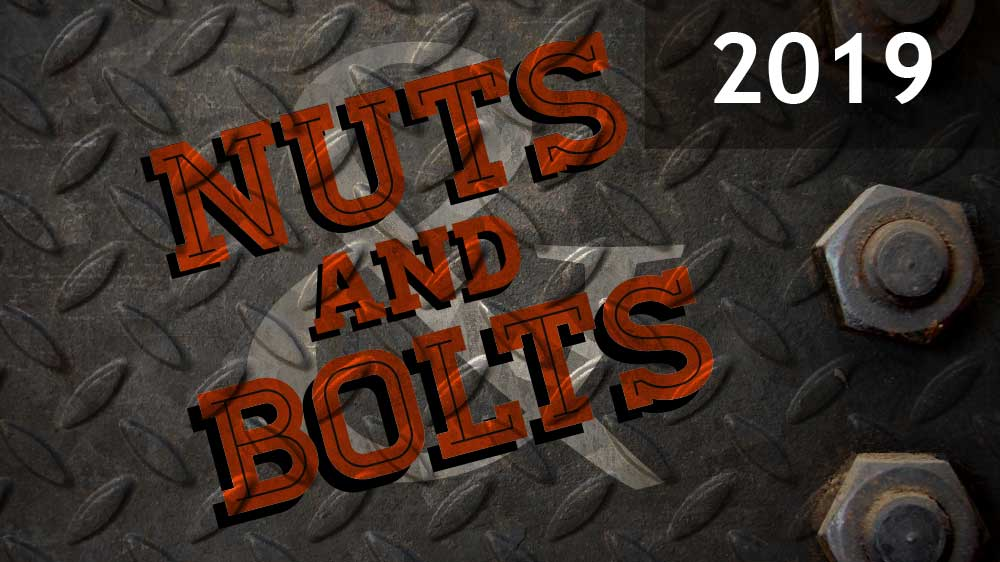 Gray sheet metal with nuts screwed in on the right side. 'Nuts and Bolts 2019' is superimposed on top