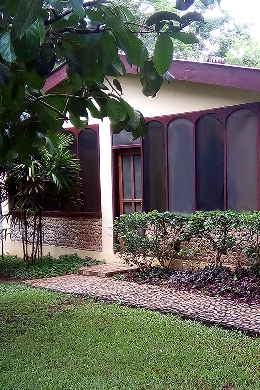 River House - Ideal for families or small groups, this house holds up to 14 guests. The house has 7 bedrooms and 4 baths. The house is divided into two suites, each with a living room and porch.