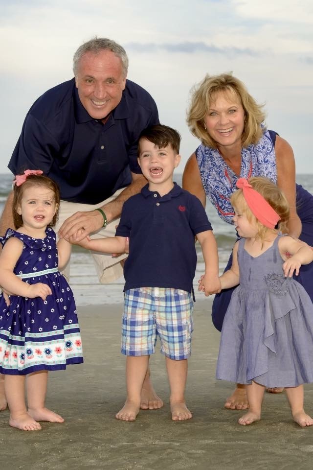 Terry, his wife pam and their grandchildren.