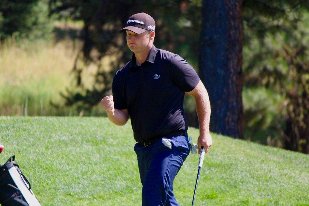 Matt Jensen celebrates a birdie putt on the 18th hole