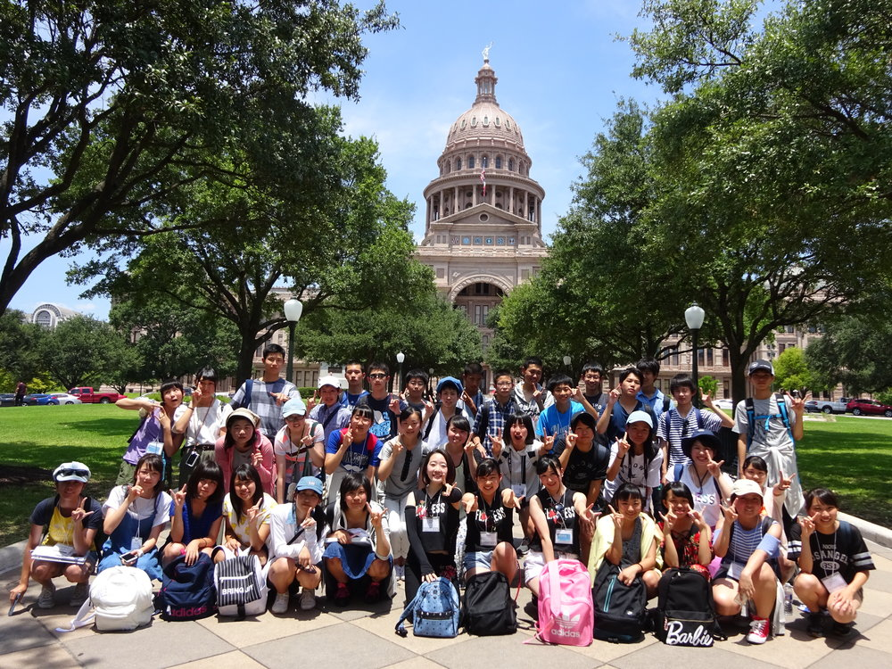 Group photo of TIEC program students at the Texas state capitol building