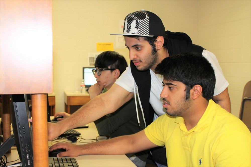 Photo of Texas International Education Consortium students working online.