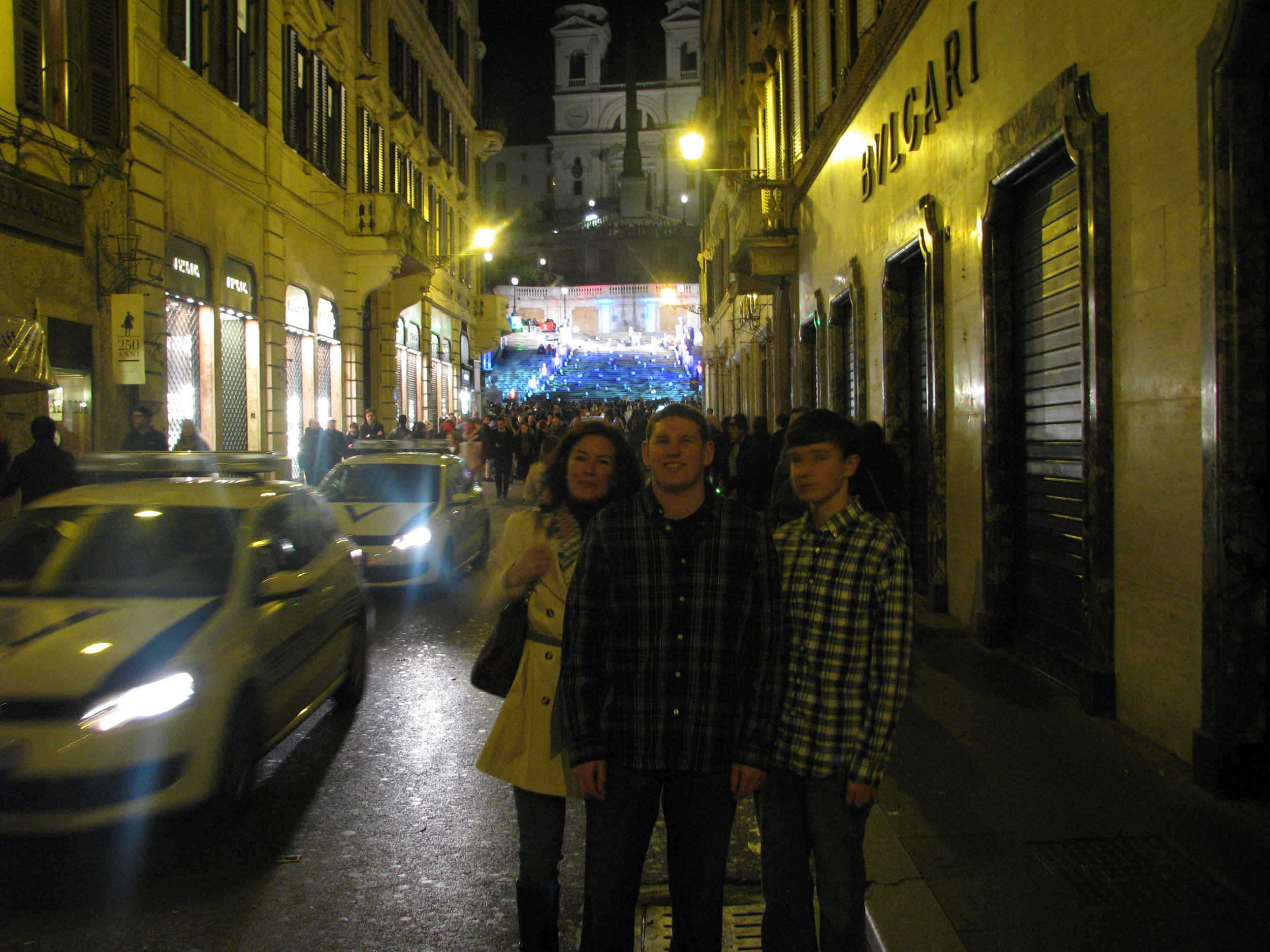 Laura, Zach and Mitch on major shopping street with Spanish Steps in background.