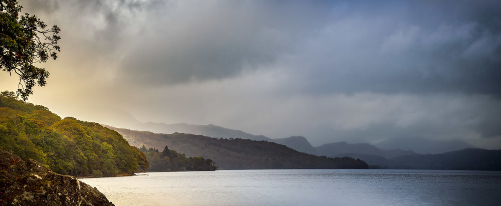 Rain sweeps over Coniston Water