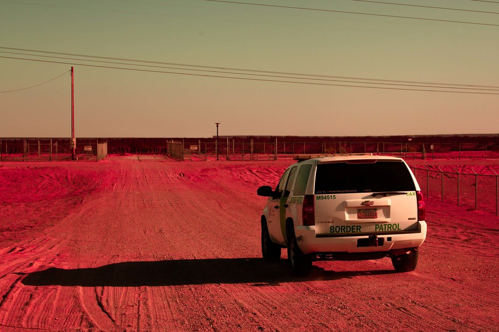 A border patrol agent passes us on the dirt road