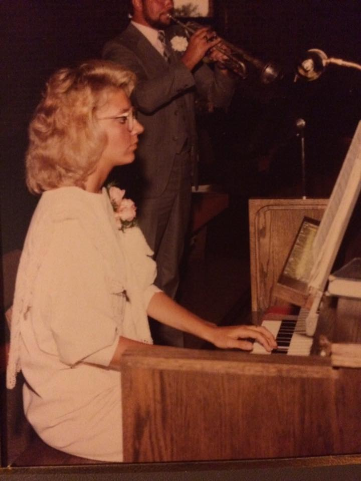 Playing organ at my cousin's wedding in 1985.
