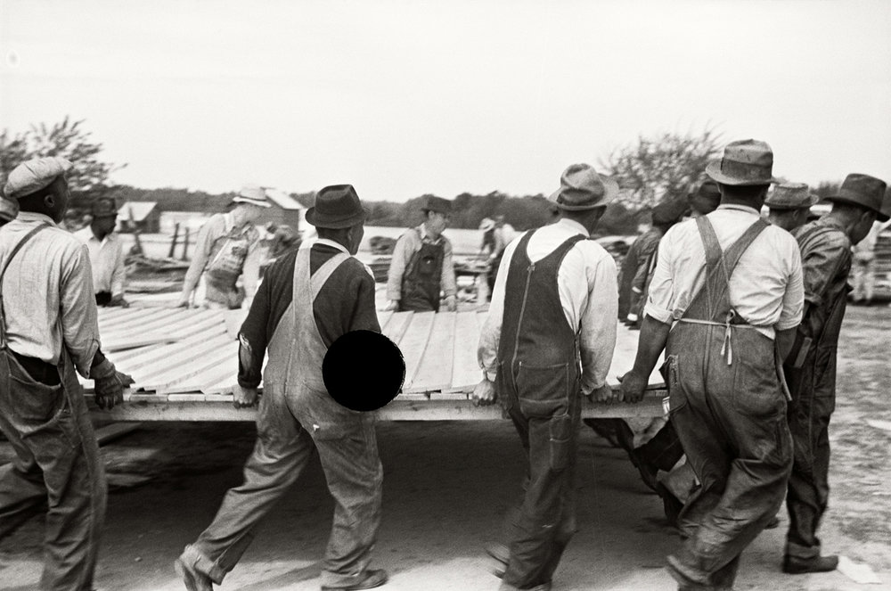69. Loading wall of prefabricated house onto truck, Roanoke Farms, North Carolina. 1938. John Vachon. 8a03103