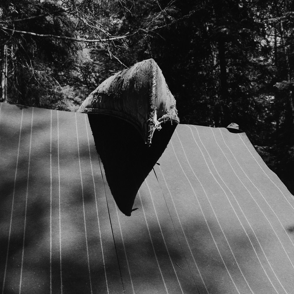 4. Birchbark Canoe and Roof, Six Nations Museum, Onchiota, NY. 1997. Toned Gelatin Silver Print.