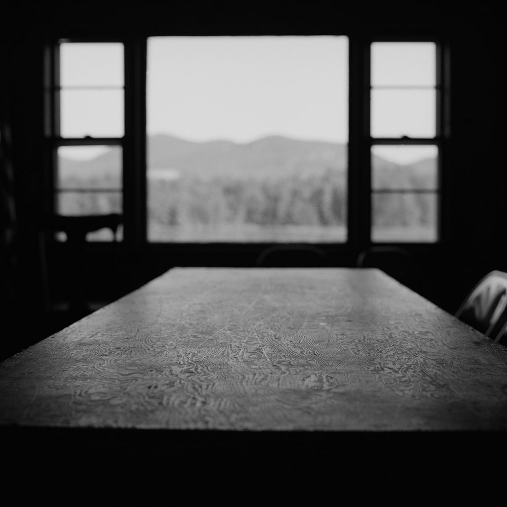 7. Table and Mt. Fay, Fish and Game Club, Lewis, NY. 2000. Toned Gelatin Silver Print.