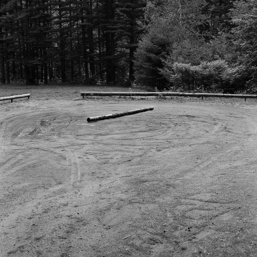 13. Log, Parking Lot, Keene, NY. 2000. Toned Gelatin Silver Print.