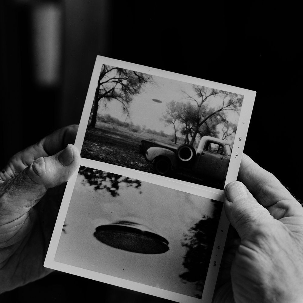 "15. Robert Shatzel Holding UFO Photographs. Lily Dale. 1996. Toned Gelatin Silver Print. 15""X15""."
