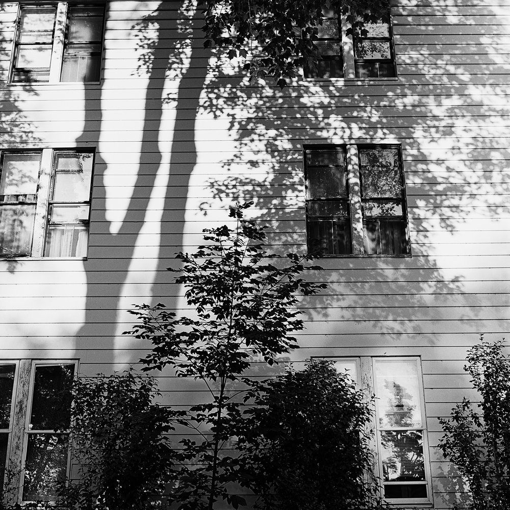 """19. Maplewood Hotel. Lily Dale. 1995. Toned Gelatin Silver Print. 15""""X15""""."""