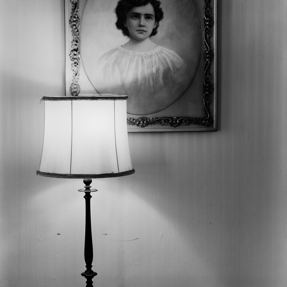 "22. Spirit Painting of Girl and Lamp, Maplewood Hotel. Lily Dale. 1996. Toned Gelatin Silver Print. 15""X15""."
