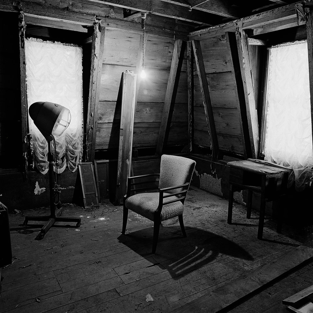"25. Attic, Buchanan House. Lily Dale. 1996. Toned Gelatin Silver Print. 15""X15""."