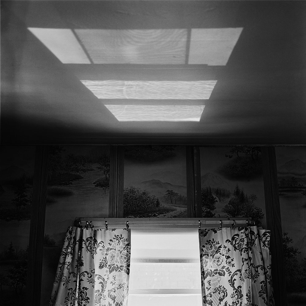 "31. Ceiling Reflection, Lewis Apartment. Lily Dale. 1996. Toned Gelatin Silver Print. 15""X15""."