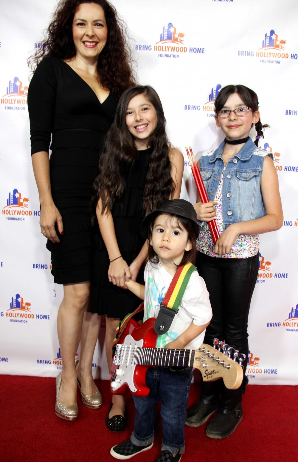 A new Guigui generation of artists brought smiles, fun and inspiration on the Bring Hollywood Home center stage. From left: Noah, Rebbeca and Esther