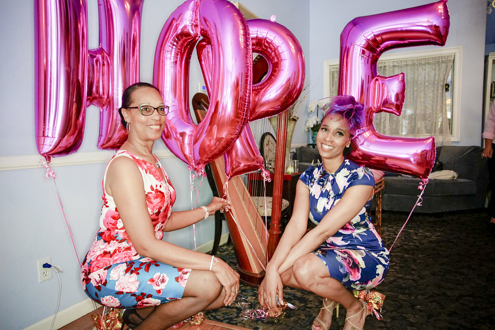 Photography by Stanley Tran  Fashionably Aware founder Tamea Scales and her mother Patricia Scales bring hope to breast cancer survivors and raise awareness during the Tata's & Tea Fashionably Aware event.