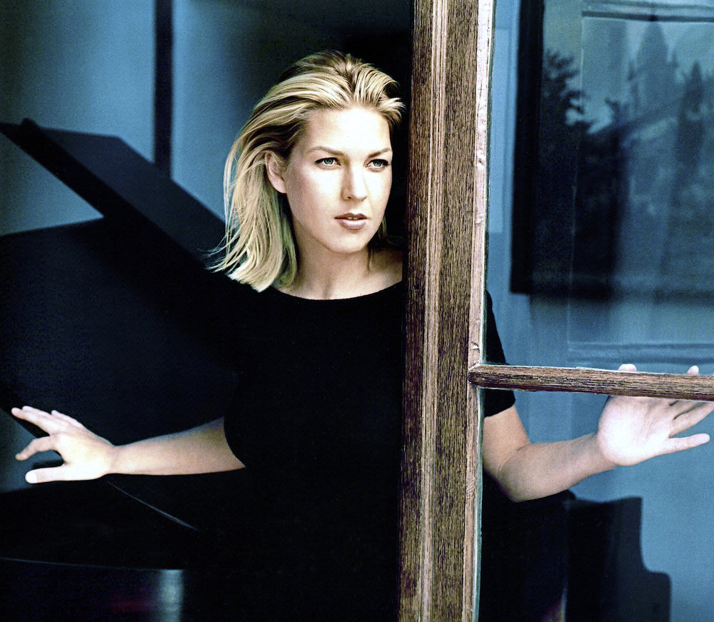 Diana Krall with Clint Eastwood's piano, also a jazz enthusiast.