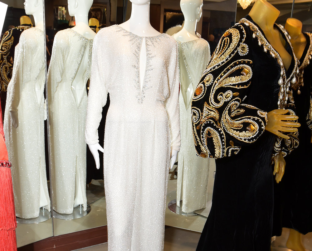 A white bateau neck wing sleeve gown designed by Sir Holman and the Black Butterfly by Bob Mackie (1969) for The Supremes.