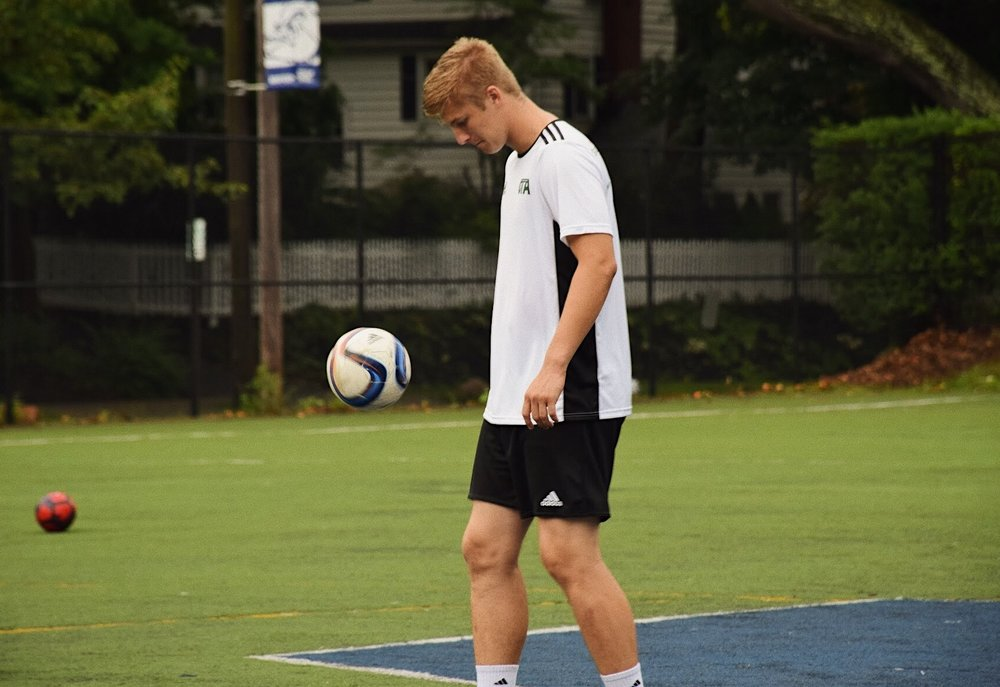 Meet Coach Phil - Phil started playing pick-up soccer at his local park until making the move into travel soccer with Bloomfield town recreation. After years with Bloomfield and NJ Stallions, Phil went to train in Brazil under Fluminense. He played his last two years of high school with MatchFit Academy, spending his senior year as a training player for New York Red Bulls Academy. Phil is a two-year varsity letter winner at Montclair High School and played his freshman year at NCAA Division I California Polytechnic. His coaching career began with private goalkeeper training under supervision of a former professional coach and player in the Italian Serie A. Phil coached private sessions for five years before joining Coach Des at Clifton Stallions to assist team coaching and goalkeeper coaching for age groups ranging from U-12 to U-19 with both girls and boys teams. He functioned in that capacity for three seasons, ultimately joining Des to help build OTA.