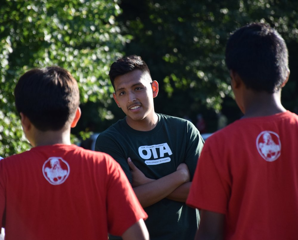 Meet Coach Jacob - Coach Baca grew up in Bloomfield, NJ where his soccer career began at a young age before joining Den of Lions. After graduating from Bloomfield High School, Baca attended Montclair State University where he received a BA in Business with a Finance concentration. Coach Baca received his first team, U13 Girls, in 2016. As a coach, Baca loves to get the best out of players each session; watching as players improve and learn about the game from multiple perspectives gives Baca a feeling of success as a coach.He hopes for players to gain knowledge of the game and confidence as a player during training sessions. In the long run, Baca wants to watch his players continue to play at the college/professional level while hoping one day to be coaching at the college level as well. Baca's long-term goal is to provide all local towns the opportunity to compete at the highest level. Our goal is to supply these smaller towns the proper training and equipment, so the youth can reach their full potential and possibly help them through college with scholarships.