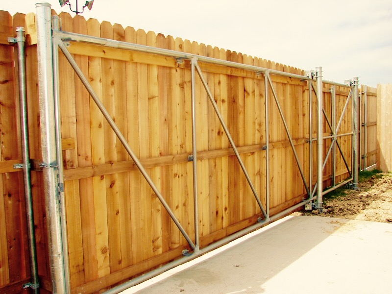 Residential slide gate - Vertical cedar with steel posts/framework