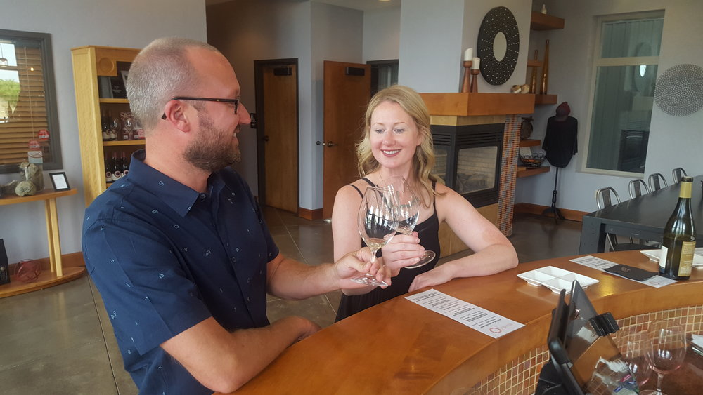 Couple wine tasting at Tertulia Cellars in Walla Walla