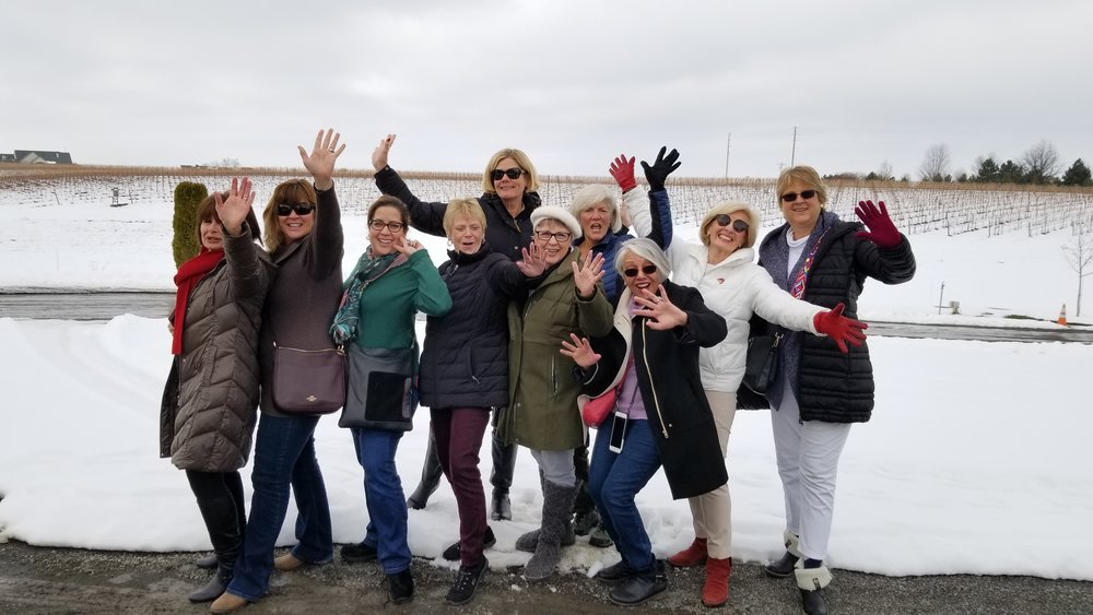 Group of women in the snow at Castillo de Feliciana winery