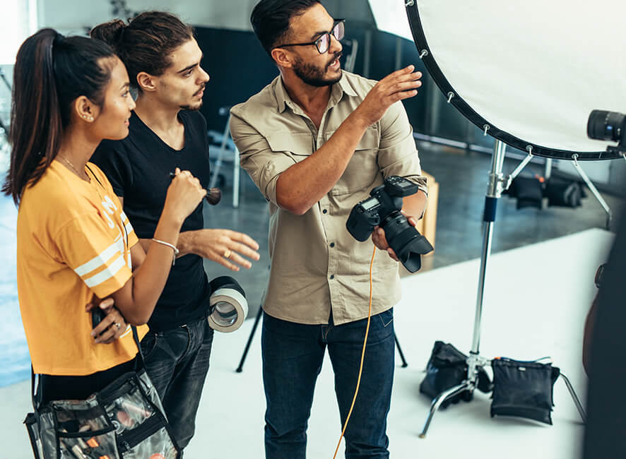 Photographer and backstage crew in a photo studio.jpg