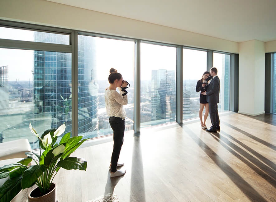 Meaningful Location - Couple being photographed in their new apartment.jpg