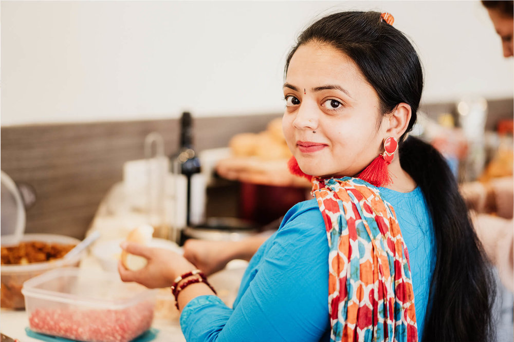 AmazingCo Refugee Degustation - Darshini (India) preparing her dish.jpg